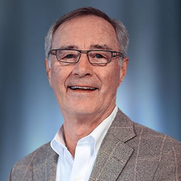 Tom E. Sween, Chairman of the Board